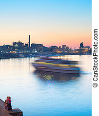 River ship motion blur - Motion blur of motor boat on a...