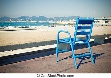 Blue chair in the Croisette, Cannes, French Riviera