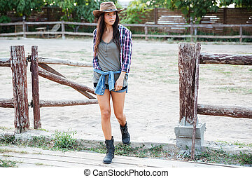 Attractive woman cowgirl waking in village - Serious...