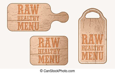 Wooden breadboard with the words raw healthy menu