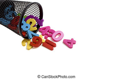 Colorful plastic numbers in black metal container isolated on white background