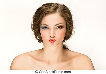 Woman With Puckered Lips - A studio portrait of a bare...
