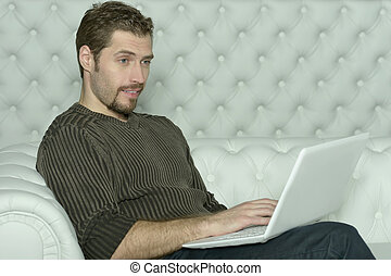 young man with computer laptop