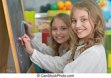 beautiful little girls at class - Portrait of a cute girls...