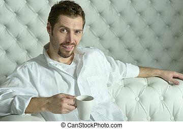man  having coffee at home