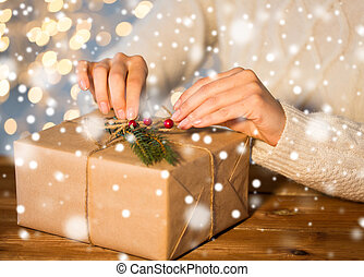 close up of woman with christmas gift or parcel - christmas,...
