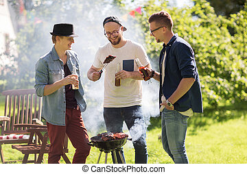 friends drinking beer at summer barbecue party