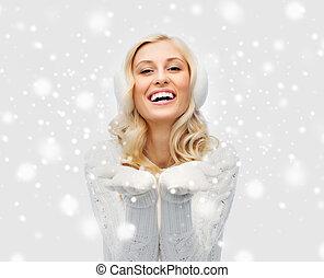 woman in winter earmuffs showing empty palms - winter,...