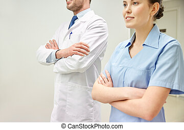 close up of doctor and nurse at hospital corridor - clinic,...