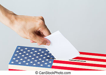 man putting his vote into ballot box on election - voting,...