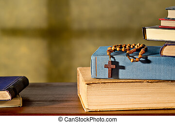 Books And Rosary - still life with books and rosary in the...
