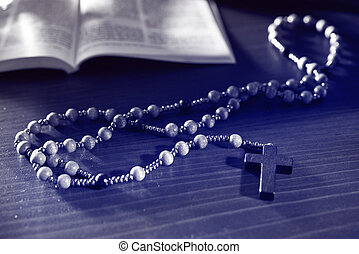 Rosary And Bible - rosary and bible on the wooden table