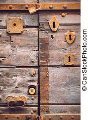 Old door with many doorlocks