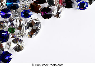 Crystals - gems - Large crystal strasses on a white...