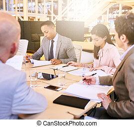 Business meeting between four professional entrepreneurial...