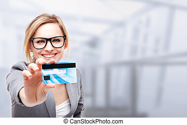 credit card -  young business woman holding new credit card