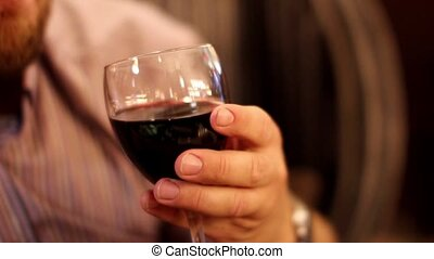 man tasting red wine. close-up