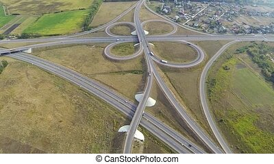 Aerial shot of highway junction with cars.
