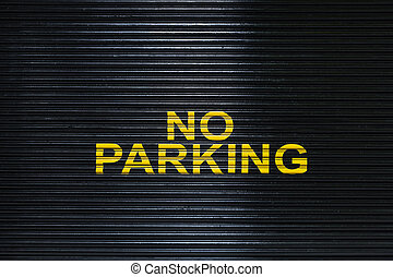 No Parking sign on a garage door