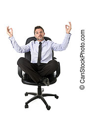 young attractive happy businessman relaxing with hands in yoga position sitting on office chair