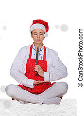 Cook in Santa hat, yoga, knife under snow on white...