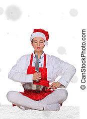 Woman cook in Santa hat, yoga, knife under snow on white...