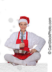 Woman cook in Santa Claus hat, yoga, knife under snow on...