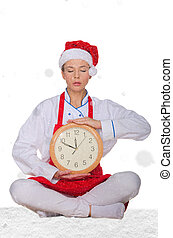 cook in Santa hat, yoga clock under snow on white background