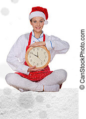 Woman cook in Santa hat, yoga clock under snow on white...