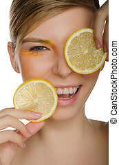 smiling woman with lemon isolated on white