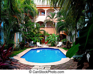 Tropical courtyard - Courtyard of tropical condos with...