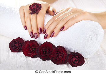 vinous manicure with rose flowers. spa - beautiful vinous...