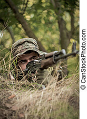 Precision is the key - Photo of a soldier pointing his...