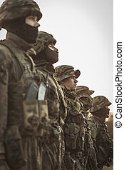 Army is their family - Group of uniformed soldiers standing...
