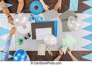 Preparing decorations for the baby shower