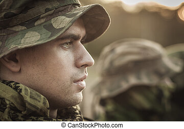 Man dedicated to his country - Close up of a young soldier...