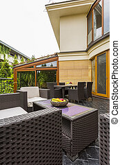 House with big terrace - Wicker patio furniture with houses...