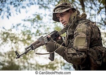 A real warrior in action - Image of a young soldier wearing...