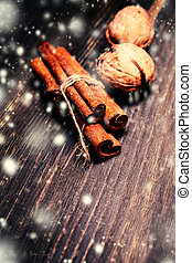 Winter spices over wooden background close up Christmas card...