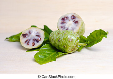 Exotic Fruit (Noni fruit and powder isolated on the wood) -...