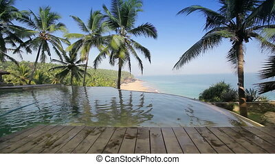 The pool on the edge of the rock overlooking the ocean and...