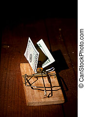 charged mousetrap money - cocked mousetrap with dollar bill...