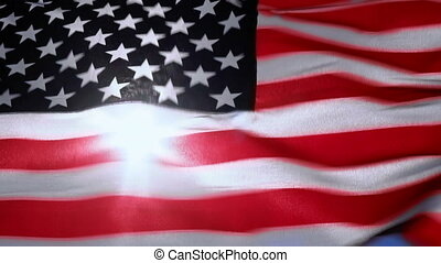 Sunlight through American flag - American flag through which...