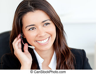 Charming asian businesswoman wearing headphones against...