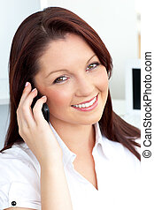 Glowing businesswoman talking on her phone