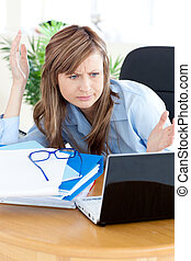 confused businesswoman with laptop - confused businesswoman...