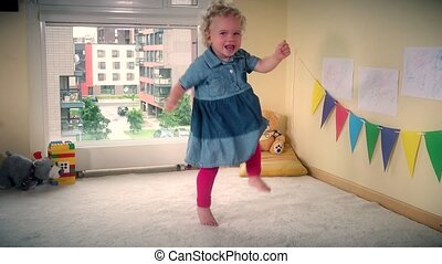 Happy hyperactive toddler child move fast in front of camera...