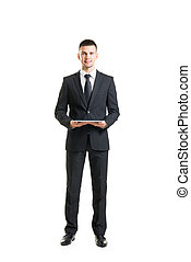 Young and confident business man holding a tablet - Young...