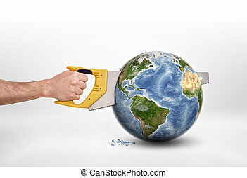 Mans hand sawing globe with saw - Mans hand sawing a globe...