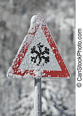 traffic sign warns of snow and ice at winter - road sign...